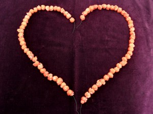 Strung Popcorn Shaped Into Two Halves of a Heart