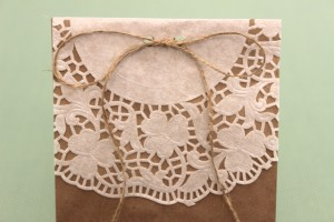 Doily-Lined Paper Bag Tied Shut With Twine