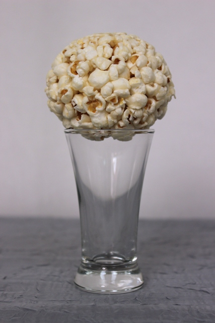 Preparing Popcorn Ball for Drizzling